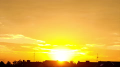 Golden sunset over suburban town silhouette with dramatic cloudscape. No Birds Stock Footage