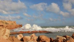 Sea waves crash against the rock Stock Footage