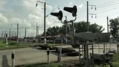 Commuter train at the railway crossing Stock Footage