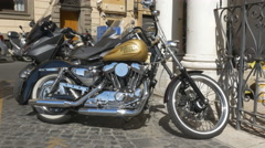 Golden Harley Davidson motorcyle parked in Rome, Italy. Stock Footage