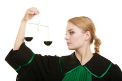 Stock Photo of woman barrister holding scales.