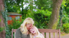4K Portrait of a happy mother & daughter with pet dog in garden Stock Footage