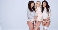 Three Sexy Ladies Wearing Shirts and Underwear Stock Footage