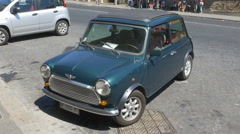 Mini parked in the street in Rome, Italy. Handheld stabilized shot. - stock footage