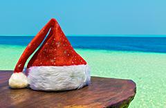Santa hat is on a beach table, Maldives, The Indian Ocean Stock Photos