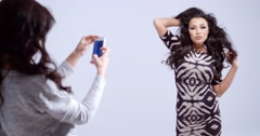 Fashion model posing for a photograph - stock footage