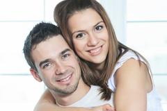 couple having great time close to the window - stock photo