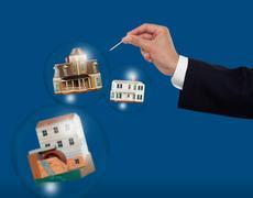 Housing market bubble burst concept - stock photo