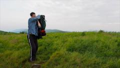 Man Putting On Backpack Stock Footage