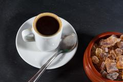 Expresso coffee with German rock sugar Brauner Kandis in bowl - stock photo