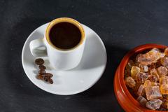 Expresso coffee with beans by German rock sugar Brauner Kandis in bowl - stock photo