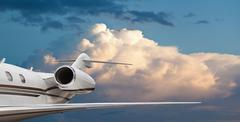 Close tail side view of a private jet flying Stock Photos