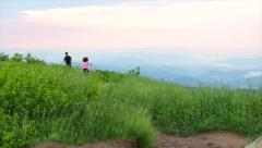 Couple Jogging On Mountain Top Stock Footage