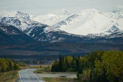 Bend in the Road Alaska Mountain Highway Transportation - stock photo