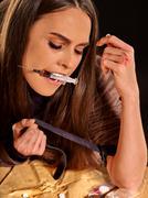 Female drug addict with   syringe - stock photo