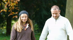 a couple goes for a walk in a park - stock footage