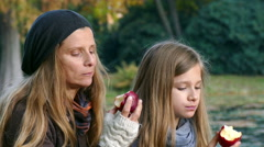 mother and daughter spending time together in a park - stock footage