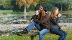 Mother and daughter spending time together in a park Stock Footage