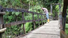 Man Looking Over Hanging Bridge - stock footage