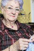 A Portrait of a happy senior woman at home - stock photo