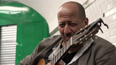 Guitarist playing in the subway underground passage. Paris. 4K. Stock Footage