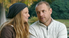 a man and a woman spending time together in a park - stock footage
