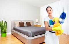Maid woman with cleaning tools. Stock Photos