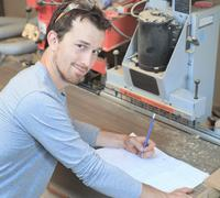 Carpenter at draw table in workshop Stock Photos