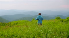 Woman Jogging On Mountain Top Stock Footage