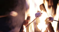 Close up of marshmallows being roasted over fire - stock footage