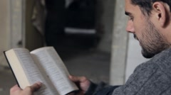 Homeless Reading the Bible - stock footage