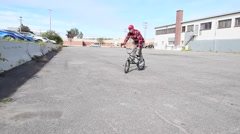 extreme bmx rider does peg trick - stock footage