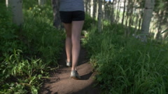 Close up of womans feet running on mountain trail - stock footage