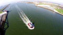 Aerial of tugboat sailing through canal near Rotterdam Harbor top down view 4k Stock Footage