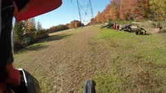 Stock Video Footage of 4k motocross wheelie under hydro town