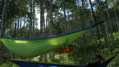 4k Young woman resting in hammock in aspen trees - stock footage