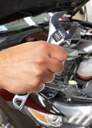 Hand of car mechanic in auto repair service. Stock Photos