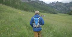 4k Young man hike on trail in Colorado mountain valley - stock footage
