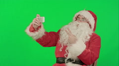 Santa Claus take a selfie on a Green Screen Chrome Key - stock footage