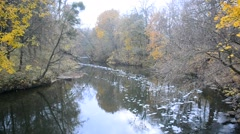 Winding river in autumn with yellow trees on river banks Stock Footage