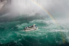 Stock Photo of Fantastic background with the ship, rainbow and Niagara falls
