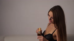 Woman in lingerie applying loose powder with brush 4K Stock Footage