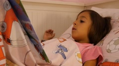 little girl reading book bedtime learning curious track shot cute child 4k - stock footage