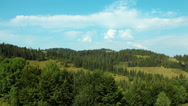 Stock Video Footage of Timelapse of clouds and beautiful green hills with coniferous trees