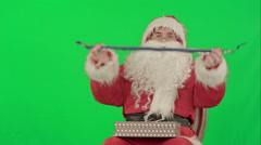 Santa Claus holding Christmas gifts on a Green Screen Chrome Key Stock Footage