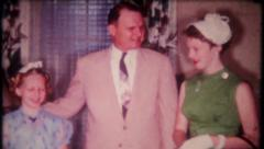 2680 - family of three dressed for formal occasion - vintage film home movie Stock Footage