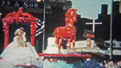 1959: College parade floats of Texas, SMU, ASU university cowgirls dancing  Stock Footage