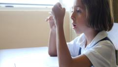 Little girl doing homework after school in uniform clever concentrated future 4k Stock Footage