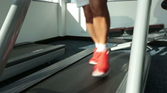 Sportman running on a treadmill HD Stock Footage