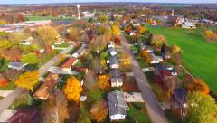 Scenic Flyover of Small Town USA in Autumn Stock Footage